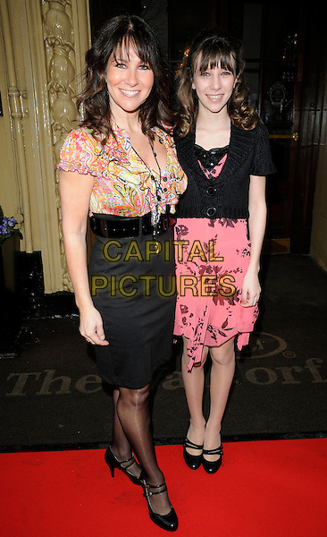 LINDA LUSARDI & DAUGHTER LUCY KANE.Tesco Magazine Mum Of The Year .Awards 2010, held at The Waldorf Hilton Hotel, Aldwych, London, England, UK,.February 28th 2010..Arrivals full length black waist pencil skirt belt high waisted top blouse print pattern pink kid child family mother mom mary janes shoes necklace paisley .CAP/CAN.©Can Nguyen/Capital Pictures