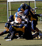 WATERBURY, CT - 23 NOVEMBER 2017 -112317JW03.jpg -- Crosby quarterback #12 Albrim Klenja is tackled by a host of Kennedy players as he tries to run the ball during the Thanksgiving Day Game at Municipal Stadium.  Jonathan Wilcox Republican-American