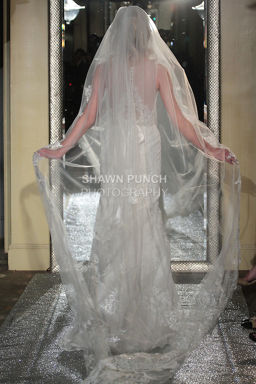 Model walks runway in a bridal gown from the Oleg Cassini Autumn Winter 2016 collection, at The Plaza Athénée Hotel, during New York Bridal Fashion Week on April 14, 2016.