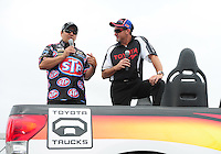 Jun. 1, 2012; Englishtown, NJ, USA: NHRA funny car driver Tony Pedregon (left) during qualifying for the Supernationals at Raceway Park. Mandatory Credit: Mark J. Rebilas-