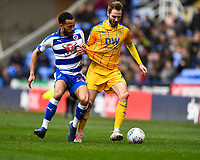 Lewis Baker of Reading left tussles with Nick Powell of Wigan Athletic  during Reading vs Wigan Athletic, Sky Bet EFL Championship Football at the Madejski Stadium on 9th March 2019