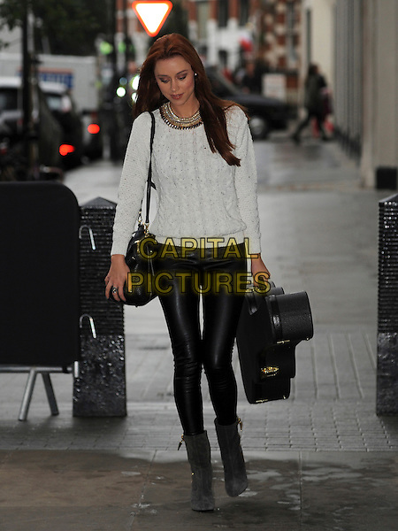 The Saturdays - Una Healy<br /> At BBC Radio 1, London, England.<br /> October 22nd, 2013<br /> full length white jumper sweater top black leather trousers guitar grey gray ankle boots bag purse <br /> CAP/AOU<br /> &copy;AOU/Capital Pictures