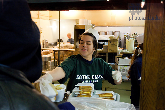 Kelly McGauley serves meals at the Manna Meals soup kitchen in downtown Detroit, Michigan.  The students were participating in the Urban Plunge project through the Center for Social Concerns...Photo by Matt Cashore/University of Notre Dame