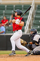 Mark Haddow #21 of the Kannapolis Intimidators follows through on his swing against the Lexington Legends at CMC-Northeast Stadium on May 20, 2012 in Kannapolis, North Carolina.  The Legends defeated the Intimidators 7-1.  (Brian Westerholt/Four Seam Images)