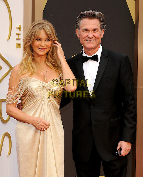 HOLLYWOOD, CA - MARCH 2: Goldie Hawn, Kurt Russell arriving to the 2014 Oscars at the Hollywood and Highland Center in Hollywood, California. March 2, 2014.  <br /> CAP/MPI/mpi99<br /> &copy;mpi99/MediaPunch/Capital Pictures
