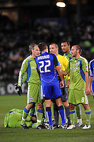 Davy Arnaud confronted by Freddie Ljungberg , Peter Vagenas #8, referee Mark Geiger...Kansas City Wizards were defeated 3-2 by Seattle Sounders at Community America Ballpark, Kansas City, Kansas.