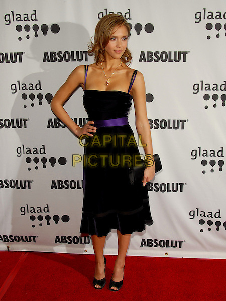 JESSICA ALBA.Attends The 17th Annual GLAAD Media Awards held at The Kodak Theatre in Hollywood, California, USA, .April 8th 2006..full length purple and black dress gold necklace ribbon belt waist hand on hip peep open toe shoes.Ref: DVS.www.capitalpictures.com.sales@capitalpictures.com.©Debbie VanStory/Capital Pictures