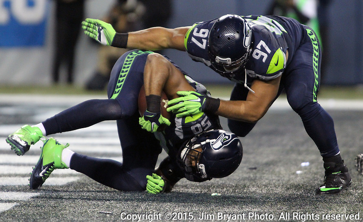 Seattle Seahawks defensive tackle Jordan Hill (97) celebrates with linebacker K.J. Wright (50) the end zone after Wright recovered a fumble by Arizona Cardinals quarterback Carson Palmer (3) at CenturyLink Field in Seattle, Washington on November 15, 2015. The Cardinals beat the Seahawks 39-32.   ©2015. Jim Bryant photo. All Rights Reserved.