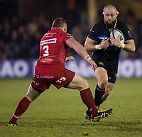 Bath Rugby's Tom Dunn evades the tackle of Scarlets&rsquo; Samson Lee<br /> <br /> Photographer Bob Bradford/CameraSport<br /> <br /> European Champions Cup Round 5 - Bath Rugby v Scarlets - Friday 12th January 2018 - The Recreation Ground - Bath<br /> <br /> World Copyright &copy; 2018 CameraSport. All rights reserved. 43 Linden Ave. Countesthorpe. Leicester. England. LE8 5PG - Tel: +44 (0) 116 277 4147 - admin@camerasport.com - www.camerasport.com