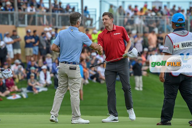 Kevin Streelman (USA) shakes hands with Mackenzie Hughes (CAN) on 18 following day 4 of the Valero Texas Open, at the TPC San Antonio Oaks Course, San Antonio, Texas, USA. 4/7/2019.<br /> Picture: Golffile | Ken Murray<br /> <br /> <br /> All photo usage must carry mandatory copyright credit (© Golffile | Ken Murray)