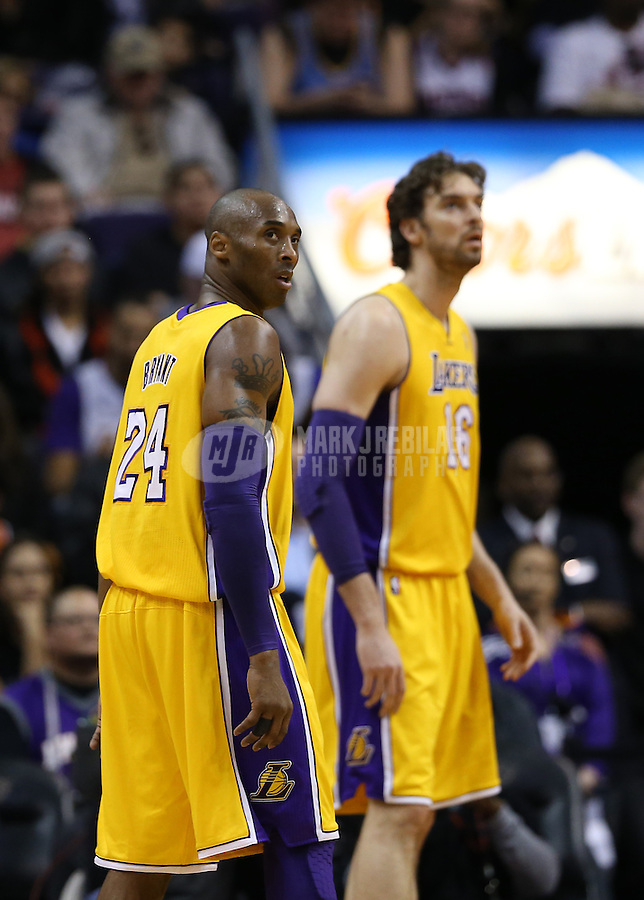 Jan. 30, 2013; Phoenix, AZ, USA: Los Angeles Lakers guard Kobe Bryant (24) and forward Pau Gasol (16) against the Phoenix Suns at the US Airways Center. Mandatory Credit: Mark J. Rebilas-