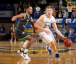 BROOKINGS, SD - DECEMBER 12: Reed Tellinghuisen #23 from South Dakota State drives to the basket against Geno Crandall #0 from North Dakota during their game Tuesday night at Frost Arena in Brookings, SD. (Photo by Dave Eggen/Inertia)