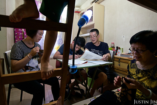 A family of five living in a  social housing estate in Hong Kong on a relatively low salary of HKD25,000.  Hong Kong has the highest rental prices in the world.