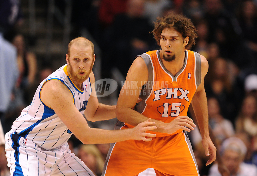 Dec. 26, 2011; Phoenix, AZ, USA; Phoenix Suns center Robin Lopez (right) and New Orleans Hornets center Chris Kaman at the US Airways Center. The Hornets defeated the Suns 85-84. Mandatory Credit: Mark J. Rebilas-USA TODAY Sports
