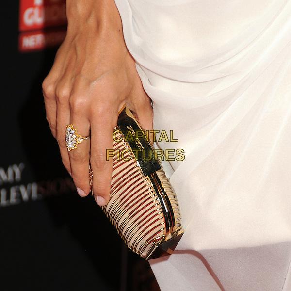 ROSARIO DAWSON'S CLUTCH BAG  .BAFTA Los Angeles 2010 Britannia Awardsz held at The Hyatt Regency Plaza Hotel, Century City, CA, USA, .4th November 2010..detail hand gold jimmy choo ring .CAP/ADM/BP.©Byron Purvis/AdMedia/Capital Pictures.
