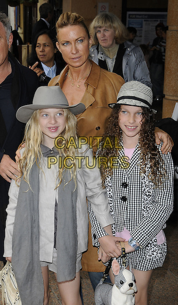 "MEG MATHEWS, DAUGHTER ANAIS GALLAGHER & GUEST.Attending the UK film premiere of ""Shrek Forever After""at Vue West End Cinema, Leicester Square, London, England, UK, June 20th 2010..half length daughter mother mum kid child grey gray scarf hat brown jacket .CAP/CAN.©Can Nguyen/Capital Pictures."