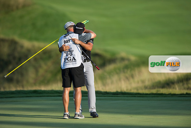 Jason Day (Aust) is all emotion with his caddie, Col  Swanton after winning the 2015 USPGA Championship at Whistling Straits (Photo: Anthony Powter)