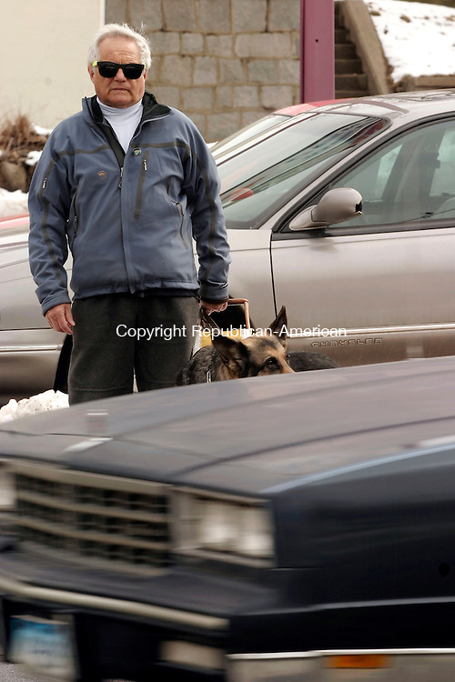 WATERBURY, CT- 25 MARCH 2005-032505J02--Waterbury resident John Casolo and his guide dog Gregger, wait to cross the street at the corner of Meriden and Frost Road in Waterbury. Casolo, 72, is blind and has trouble crossing at the intersection and is asking of audible traffic signals at major intersections.--- Jim Shannon Photo-- John Casolo; Waterbury; Gregger, Meriden,  Frost Road are CQ