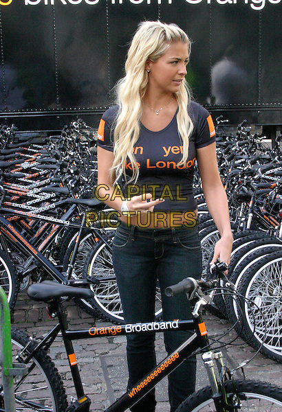 "GEMMA ATKINSON.Orange - official telecommunications partner of the Tour De France 2007 ? is giving away 500 mountain bikes and helmets worth £200 each, in support of its ""On Your Bike, London"" initiative. .Covent Garden, London, England, 4th July 2007..half length black t-shirt trousers .CAP/ELI.©Matt Elliott/Capital Pictures."