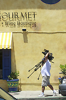 May 15 2008, Pacific Beach, San Diego, CA, USA:  A TV cameraman moves his tripod outside the French Gourmet resturant on Turquoise Street after it was rraided earlier in the day. Eyewitnesses said that the street was closed for a block or two during the raid just before 8am.