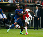 Paul Pogba of Manchester United in action with Bertrand Traore of Ajax during the UEFA Europa League Final match at the Friends Arena, Stockholm. Picture date: May 24th, 2017.Picture credit should read: Matt McNulty/Sportimage