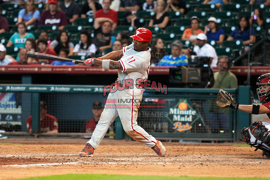 Philadelphia Phillies shortstop Jimmy Rollins #11 swings during the Major League baseball game against the Houston Astros on September 16th, 2012 at Minute Maid Park in Houston, Texas. The Astros defeated the Phillies 7-6. (Andrew Woolley/Four Seam Images).