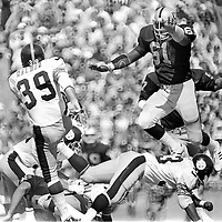 Oakland Raiders #61 Herb McMath    trys to block punt of Pittsburg Steelers #39 ..(1976 photo/Ron Riesterer)