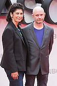 London, UK. 11 July 2016. Producer Amanda Posey and writer Nick Hornby. Red carpet arrivals for the European Premiere of the Universal movie Jason Bourne (2016) in London's Leicester Square.