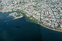 Water pollution, aerial view of Guanabara bay at the border of densely populated Ilha do Governador ( Governor Island ), Rio de Janeiro, Brazil - the bay has been heavily impacted by urbanization, deforestation, and pollution of its waters with sewage, garbage, and oil spills.
