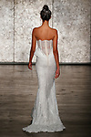 Model walks runway in a VIP sparkling strapless sequin mermaid with Chiffon accents at waist, from Inbal Dror Fall 2018 bridal collection on October 5, 2017; during New York Bridal Fashion Week.