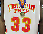 Winston-Salem Prep's Greg Howard proudly wears a State Championship medal after his team beat Plymouth 61-49 at the Dean Smith Center in Chapel Hill, NC, on Saturday, March 10, 2012.  Photo by Ted Richardson