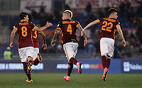 Calcio, Serie A: Roma vs Inter. Roma, stadio Olimpico, 19 marzo 2016.<br /> Roma's Radja Nainggolan, center, celebrates with teammates Diego Perotti, left, and Stephan El Shaarawy after scoring during the Italian Serie A football match between Roma and FC Inter at Rome's Olympic stadium, 19 March 2016. The game ended 1-1.<br /> UPDATE IMAGES PRESS/Isabella Bonotto