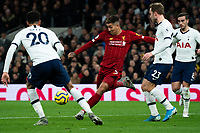 Liverpool's Roberto Firmino takes a shot despite the attentions of Tottenham's Christian Eriksen and Dele Alli<br /> <br /> Photographer Stephanie Meek/CameraSport<br /> <br /> The Premier League - Tottenham Hotspur v Liverpool - Saturday 11th January 2020 - Tottenham Hotspur Stadium - London<br /> <br /> World Copyright © 2020 CameraSport. All rights reserved. 43 Linden Ave. Countesthorpe. Leicester. England. LE8 5PG - Tel: +44 (0) 116 277 4147 - admin@camerasport.com - www.camerasport.com