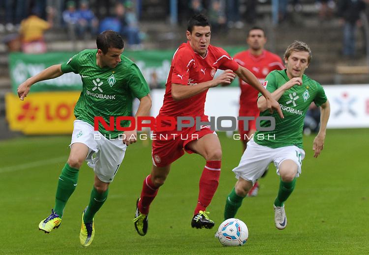 26.07.2011, MEP Arena, Meppen, GER, FSP, Werder Bremen vs Olympiakos Pir&auml;us, im Bild Lukas Schmitz (Bremen #13), Petar Grbic (Piraeus #29), Marko Marin (Bremen #10)<br /> <br /> // during friendly match Werder Bremen vs Olympiakos Pir&auml;us on 2011/07/26,  MEP Arena, Meppen, Germany.<br /> Foto &copy; nph / Frisch