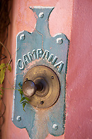 Detail of a metal bell-pull with a trompe l'oeil door plate
