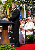 U.S. President George W. Bush (L) speaks as Pope Benedict XVI (R) listens on the South Lawn at the White House in Washington, D.C. USA on 16 April 2008. Today is the second day of the pope's visit to the United States.  Today is also  the 81st birthday of the pope.