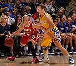 SIOUX FALLS, SD - MARCH 12:  Alexis Yackley #5 of the University of South Dakota shields the ball from Gabby Boever #4 of South Dakota State during their championship game at the 2013 Summit League Tournament at the Sioux Falls Arena Tuesday. (Photo by Dick Carlson/Inertia)