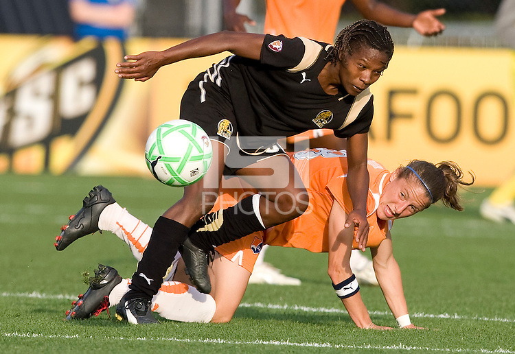 03 May 2009: Formiga of the FC Gold Pride steals the ball away from Julianne Sitch of the Sky Blue during the game at Buck Shaw Stadium in Santa Clara, California.   FC Gold Pride defeated Sky Blue FC, 1-0.
