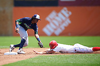 Vermont Lake Monsters shortstop Eric Marinez (2) tags Jack Sundberg (5) out attempting to steal second during a game against the Auburn Doubledays on July 13, 2016 at Falcon Park in Auburn, New York.  Auburn defeated Vermont 8-4.  (Mike Janes/Four Seam Images)