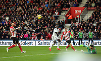 Pictured: A shot by Bafetimbi Gomis of Swansea (C) is deflected by Southampton goalkeeper Fraser Forster (R) Sunday 01 February 2015<br />