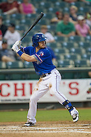 Round Rock Express third baseman Jason Donald (5) at bat during the Pacific Coast League baseball game against the Omaha Storm Chasers on June 1, 2014 at the Dell Diamond in Round Rock, Texas. The Express defeated the Storm Chasers 11-4. (Andrew Woolley/Four Seam Images)