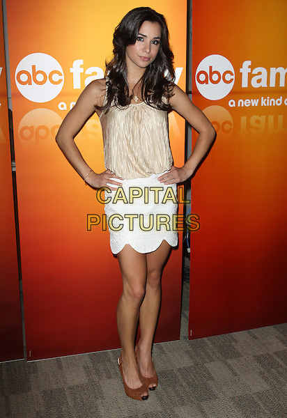 JOSIE LOREN  .Disney/ABC Television Group Press Junket held At The ABC Television Network Building, Burbank, California, USA..May 15th, 2010.full length top gold beige skirt white brown peep toe shoes hand on hip.CAP/ADM/KB.©Kevan Brooks/AdMedia/Capital Pictures.