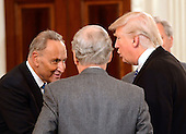 United States President Donald Trump, right, welcomes US Senate Minority Leader Chuck Schumer (Democrat of New York), right, and US Senate Majority Leader Mitch McConnell (Republican of Kentucky), center as he hosts a reception for US House and US Senate Republican and Democratic leaders in the State Dining Room of the White House in Washington, DC on Monday, January 23, 2017.<br /> Credit: Ron Sachs / Pool via CNP