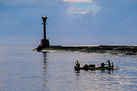 Indonesia, Sulawesi, Manado. Manado harbour with a lighthouse on the pier.