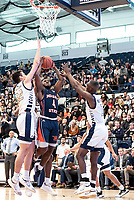 WASHINGTON, DC - NOVEMBER 16: Javier Langarica #32 of George Washington blocks a shot by Kyson Rawls #4 of Morgan State during a game between Morgan State University and George Washington University at The Smith Center on November 16, 2019 in Washington, DC.