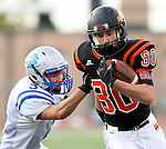 SIOUX FALLS, SD - OCTOBER 16:  Logan Uttecht #80 from Washington tries to slip past Cade Ellis #3 from Rapid City Stevens in the first half of their game Friday night at Howard Wood Field. (Photo by Dave Eggen/Inertia)