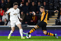 Matt Grimes of Swansea City and Ryan Taylor of Hull City during the Capital One Cup match between Hull City and Swansea City played at the Kingston Communications Stadium, Hull
