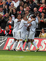 Pictured: Nathan Dyer (TOP) celebarting his goal with team mates. Saturday 17 September 2011<br /> Re: Premiership football Swansea City FC v West Bromwich Albion at the Liberty Stadium, south Wales.