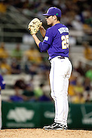 LSU Tigers pitcher Joey Bourgeois #25 looks in for the catchers sign against the Mississippi State Bulldogs during the NCAA baseball game on March 17, 2012 at Alex Box Stadium in Baton Rouge, Louisiana. The 10th-ranked LSU Tigers beat #21 Mississippi State, 4-3. (Andrew Woolley / Four Seam Images).