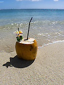 Flic en Flac, Mauritius. La Pirogue tourist resort. Coconut cocktail on the beach.